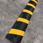 yellow and black speed bump